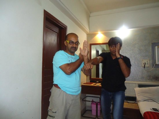Pravasi Hotel : demonstrating some karate moves to a student