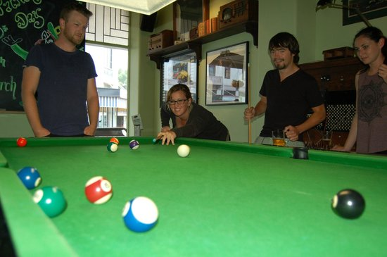 Play pool with mates at The Rose Irish Pub