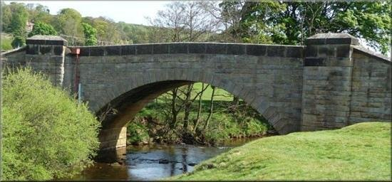 bridge over the river Esk and at the bottom of the Eskdale inn beer garden