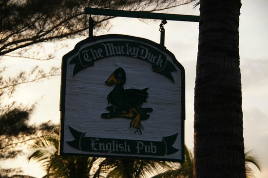The Mucky Duck sign at entrance to parking lot