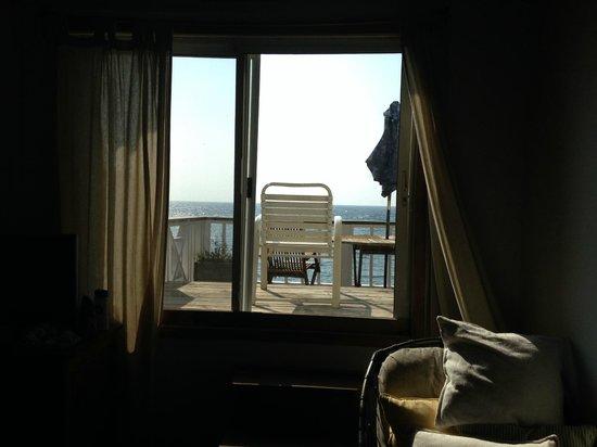 The Beach House : Door to rooftop balcony in room D