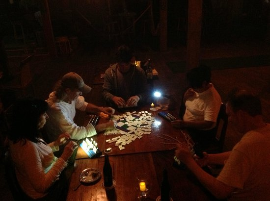 Itza Lodge : Game Night by candlelight (electricity temporarily out)...