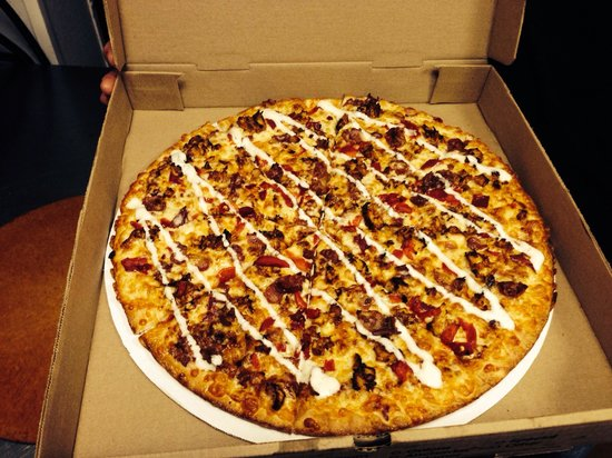 Teaticket, MA: Texas style pizza - cheese, BBQ chicken, roasted red pepper, bacon with BBQ sauce and ranch!