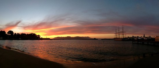 Fisherman's Wharf: Sunset over the Bay, Golden Gate Bridge in the distance