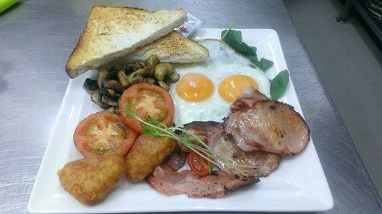 Our Place Kitchen: Our big heart breakfast with eggs cooked to your liking and the option of bacon or sausages
