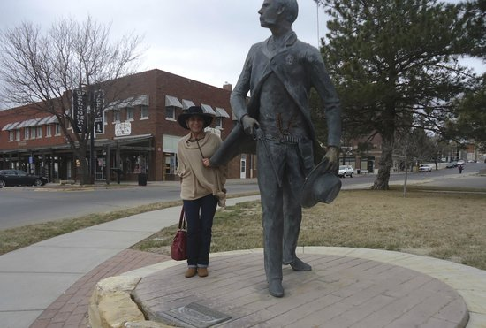 Cowboy Statue On Boot Hill: Me visiting Wyatt Earp in Dodge City… Weather was chilly, but it was worthy to meet the legend :