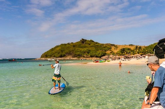 Captain Alan's Three Island Snorkeling Adventure: Paddle boarding at Pinel