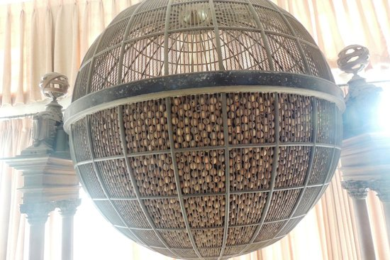 Goa State Museum: historic manual lottery machine closeup view of wooden balls with numbers engraved