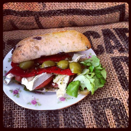 Geranium Coffee: Olive foccaicia, with brie, fresh pesto and roasted red peppers