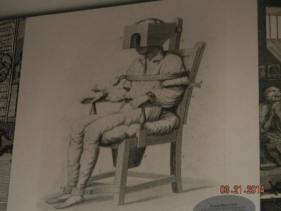 Public Hospital Museum: man in restriction device