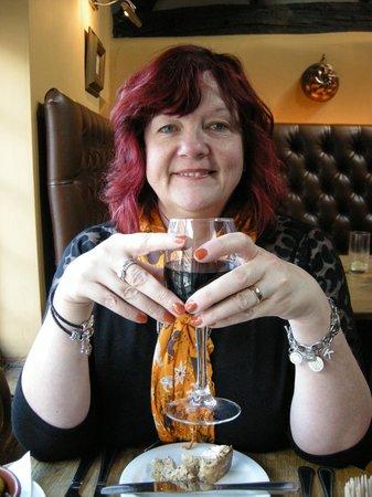 Vintner: Enjoying a glass of Merlot before the starters arrive!!