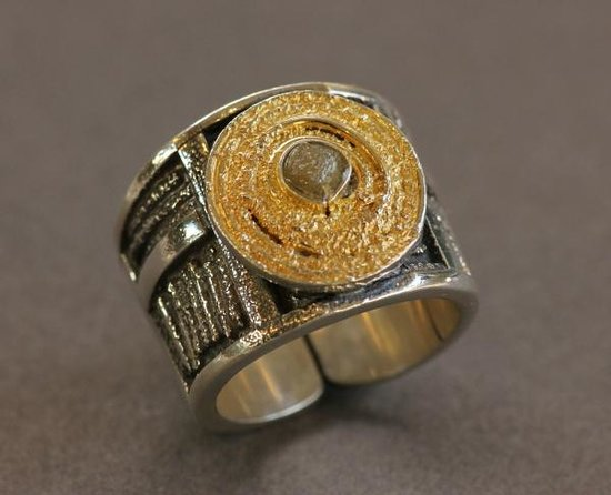 DeLong Studio: Rough diamond on a silver band with gold accent