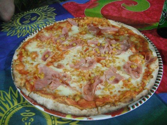 Dominican pizza (tomato, ham, cheese and corn)