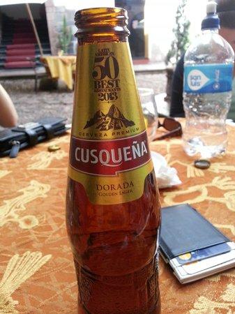 MARQUESES Boutique Hotel : Enjoying a Cusquena in the courtyard