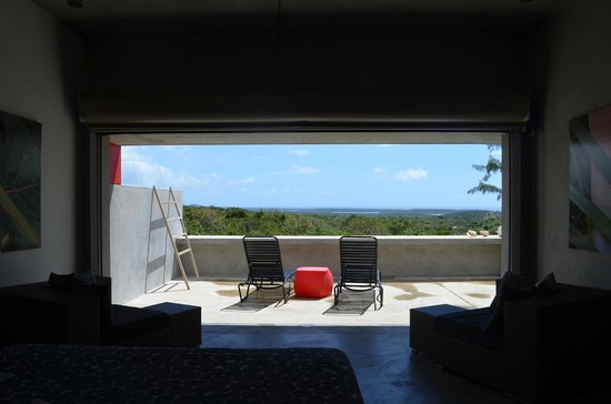 Hix Island House: Solaris 1 looking at patio from inside room