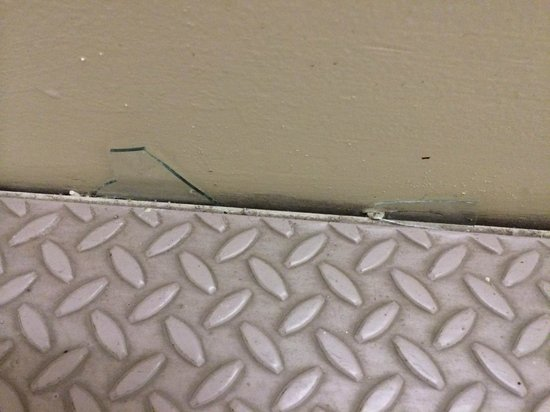 Sacramento Marriott Rancho Cordova: Note shards of glass swept aside but not removed for 2+ weeks