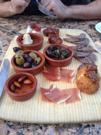 LaSalette Restaurant: Tasting platter with 7 options  including cheese, sausage, olives and escargots.