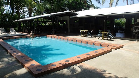 Beachside Resort: Poolside.  Bar located to the left, kitchen/dining located to the right.