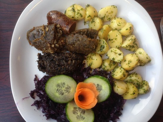The Cookhouse Cafe: 3 celebratory sausages with fragrant cabbage..again a heritage dish.