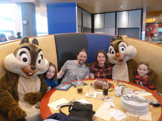 Chip and Dale at our table in Cafe Mickey with birthday cake