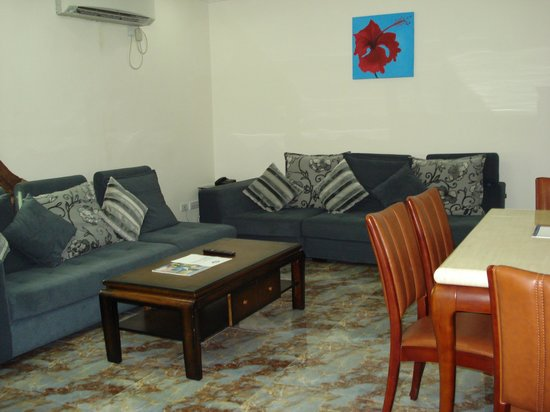 AES Luxury Apartments: the sitting room with dining
