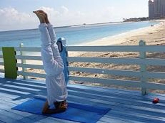 Sivananda Ashram Yoga Retreat: headstand at the beach platform