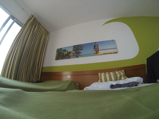 Surfing Colors Apartments: Muro stanza da letto