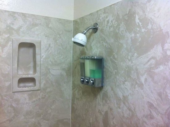 Quality Inn Suites Shower With Dispenser Full Of Shampoo Conditioner Body Wash