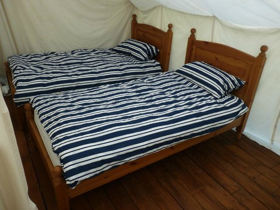 Safari Glamping: Single beds with feather duvet and cotton sheets