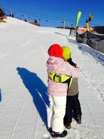 Canyons Village at Park City: Twins hugging after a day of skiing