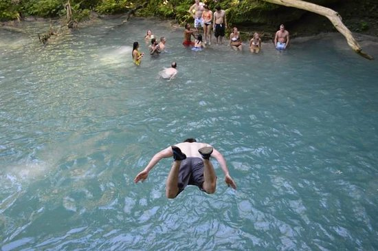 Peat Taylor Tours jumping in Blue Hole
