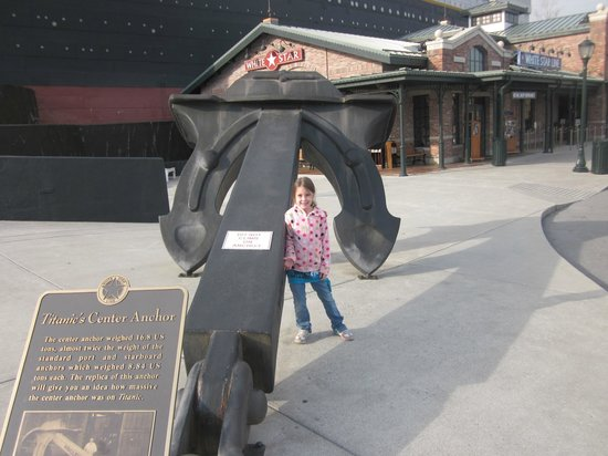 Titanic Museum Attraction: My daughter(7) by the anchor.