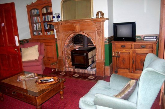 Mariton House: Sitting room with wood fire