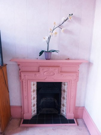 The Sussex Hotel: Bedroom fireplace