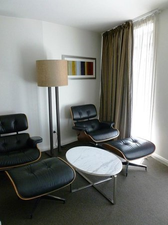 Mantra Collins Hotel: One bedroom apartment lounge