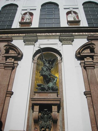 Michaelskirche: The outer facade of our archangel Michael slaying the dragon
