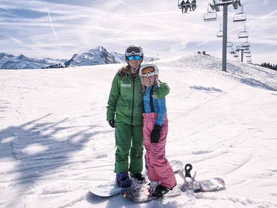 molly with her mint snowboarding instructor