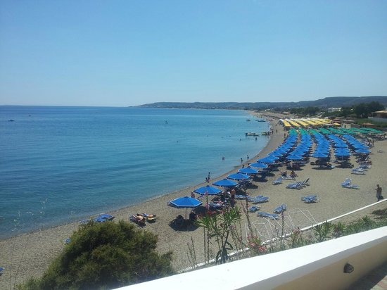 Mitsis Family Village Beach Hotel: Beach with clear calm water.