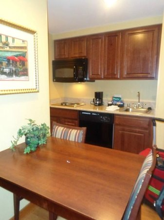 Homewood Suites by Hilton Portland: table with kitchen area in background