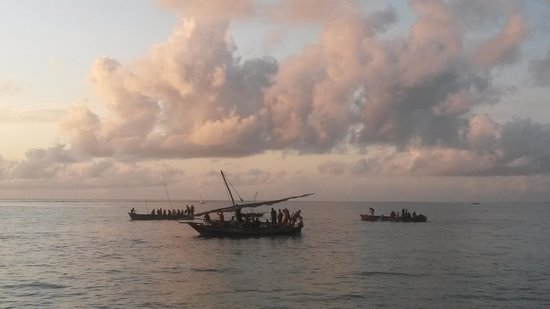 Kasha Boutique Luxury Hotel: awaiting sunrise in the morning, boats in the neighbouring village setting out for the day