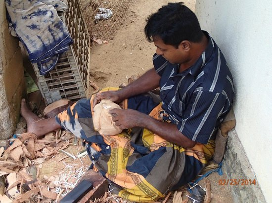 Coconut Tours - Private Day Tours: Villager carving coconuts.