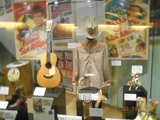 Country Music Hall of Fame and Museum: Gene Autrey display of boots, guitar, shirt, hat, belt, & posters.