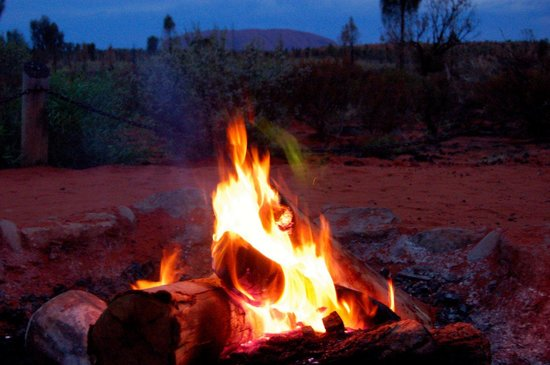 Red Centre, Australia: fire with Uluru background