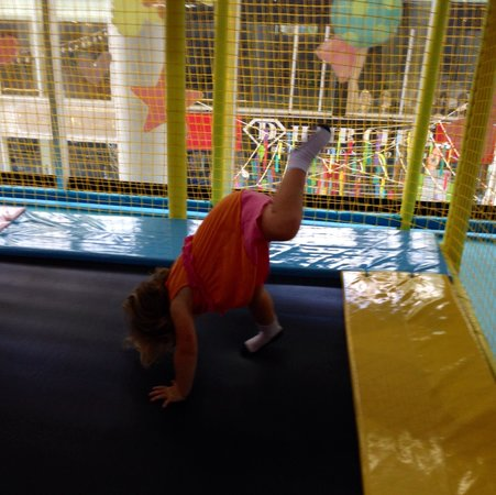 The Kids Club Phuket: Attempting a handstand on trampoline!