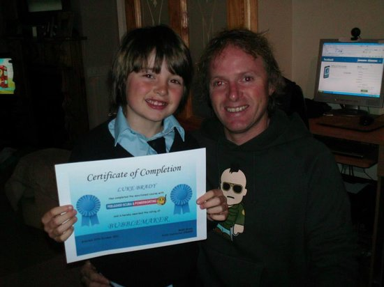 Feelgood Activities: Ralph Brady presents Luke Brady with Bubblemaker Certificate