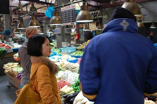 Shanghai, China: Showing us around a market