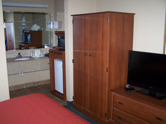 """Quality Inn Kennesaw: Dresser, """"closet"""", and ref/micro all in a row"""