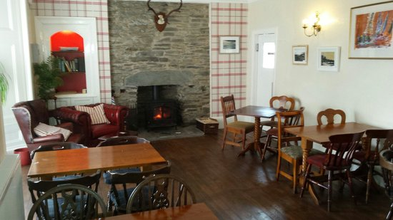 The Osborne: Comfy lounge for relaxing with log burning stove. Excellent for those cold, wet nights.