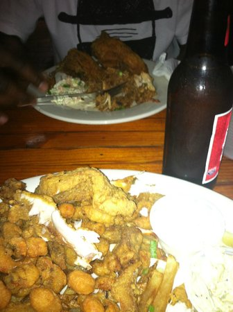 Coop's Place: Fried seafood platter and Cajun fried chicken
