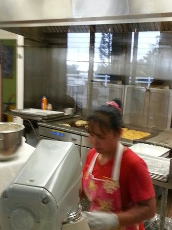 Tex Drive In & Restaurant: You can watch through the glass to see how the malasadas are made.